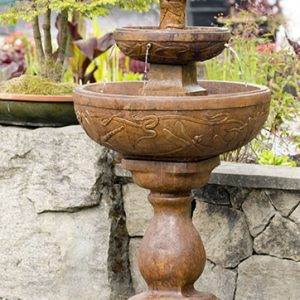 Dragonfly Fountain, stained concrete water feature for outdoor garden or patio