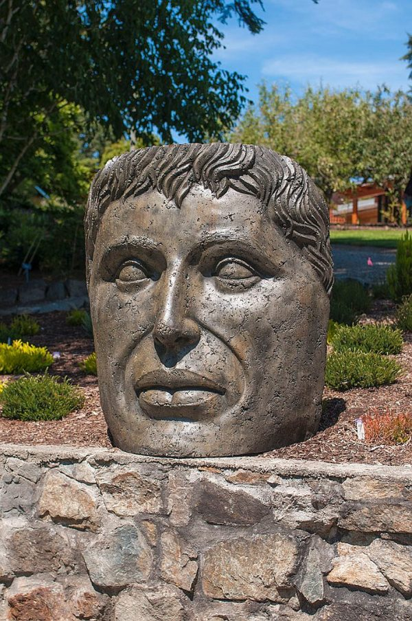 Giant Young Emperor, stained concrete face for outdoor garden or patio