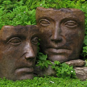Portrait of Mother Nature, stained concrete faces for outdoor garden or patio