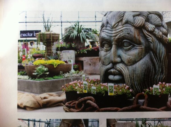 Neptune acid stained concrete face statue for garden or patio