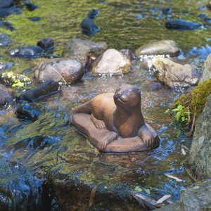 Otter baby, stained concrete animal for outdoor garden or patio