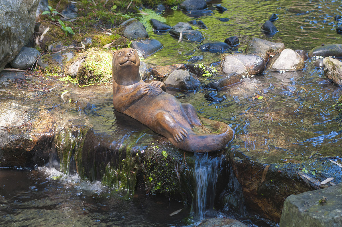 Otter Mother, stained concrete animal for outdoor garden or patio