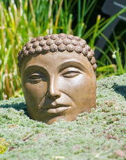 Buddha Face Small, stained concrete face for outdoor garden or patio