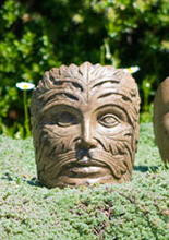 Small Greenman Face, stained concrete face for outdoor garden or patio