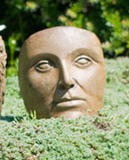 Small Portrait of Mother Nature, stained concrete face for outdoor garden or patio