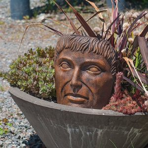 Tabletop Young Emperor, stained concrete face for outdoor garden or patio