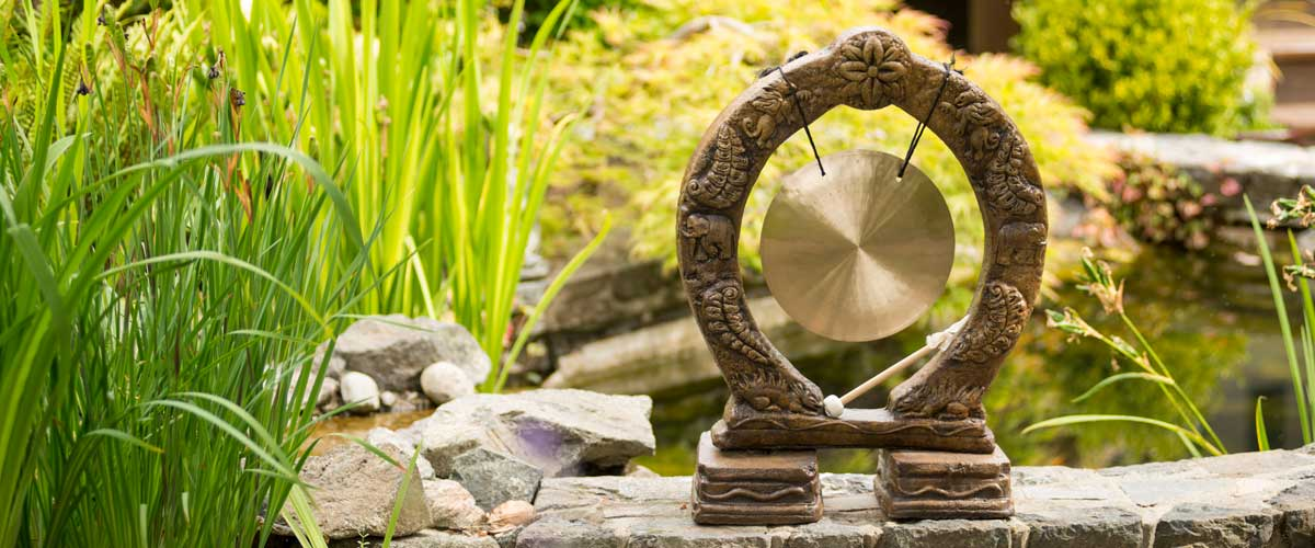 Buddhist Gong, stained concrete ornament for outdoor asian garden or patio