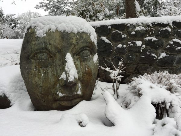 Giant Portrait of Mother Nature garden face ornament, statue in the snow