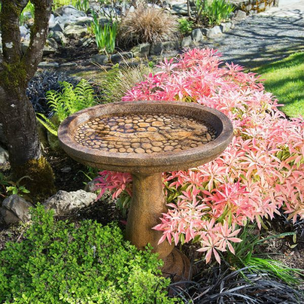 Lady of the Lake Birdbath, concrete bird bath features a lady nestled in the rocks